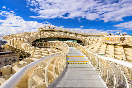 metropol parasol: SEVILLE, SPAIN - OCTOBER 7, 2014: The Metropol Parasol walkway. Located in the old quarter, the structure opened to public controversey in 2011. Editorial