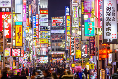 TOKYO, JAPAN - MARCH 14, 2014: Signs densely line an alleyway in Kabuki-cho. The area is a renown nightlife and red-light district. Editorial