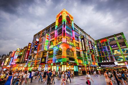 GUANGZHOU, CHINA - MAY 25, 2014: Pedestrians pass through Shangxiajiu Pedestrian Street. The street is the main shopping district of the city.
