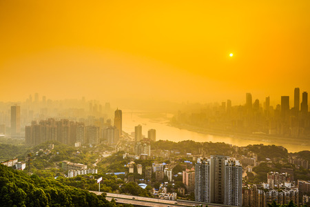 hazy: downtown city skyline over the Jialing River during a hazy sunset in Chongqing, China