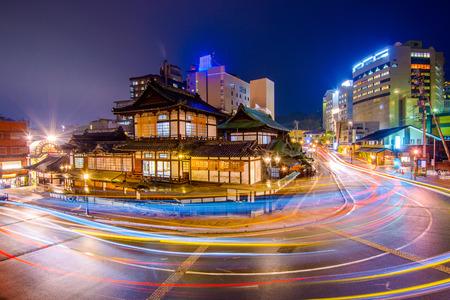 onsen: downtown skyline at Dogo Onsen bath house in Matsuyama, Japan