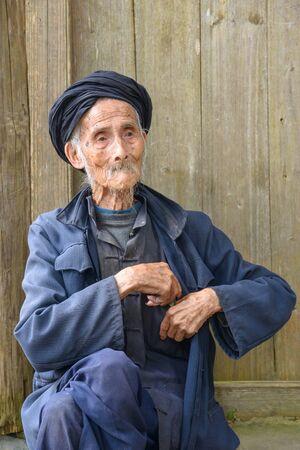 centenarian: An elderly member of the Yao minority people in Tiantou Village, Guangxi, China. Editorial