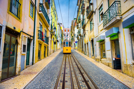 lisbon: old town streets and street car in Lisbon, Portugal