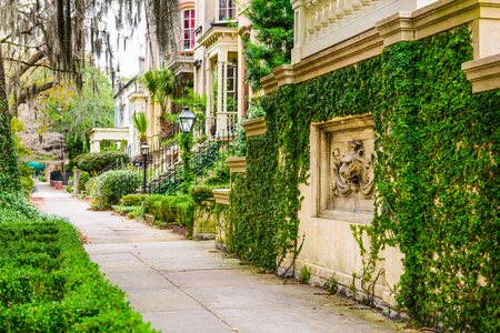 historic downtown sidewalks and row houses in Savannah, Georgia, USA