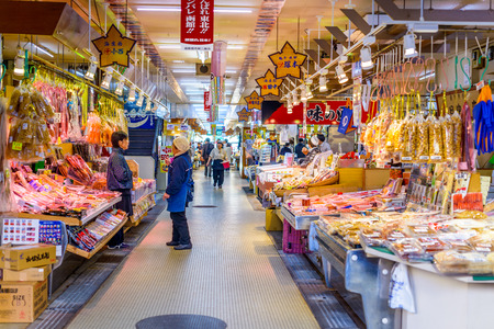 hokkaido: HAKODATE, JAPAN - OCTOBER 25, 2012: Workers set up for the morning market. The collection of over 300 stalls operates daily from 5 a.m. and is popular early morning attraction.