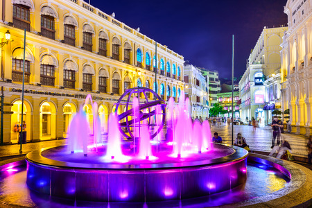 macao: MACAU, CHINA - MAY 21, 2014: People enjoy Senado Square. The territory was the last European colony in Asia and the architecture is inspired by the former Portuguese rule. Editorial