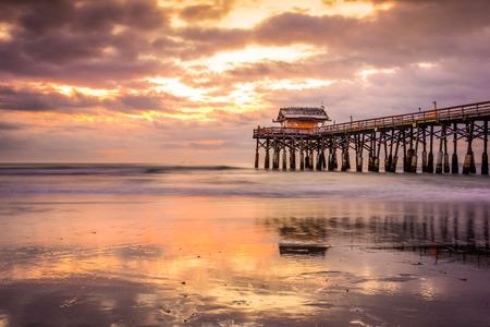 fl: beach and pier at sunrise in Cocoa Beach, Florida, USA Stock Photo