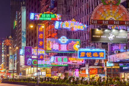 sha: HONG KONG, CHINA - OCTOBER 8, 2012: Neon billboards on Nathan Road. The street is a main thoroughfare through Kowloon and is lined with shops and restaurants.