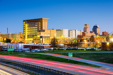twilight: Durham, North Carolina, USA downtown city skyline.