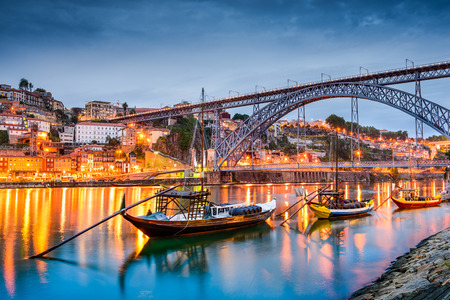 rabelo: Porto, Portugal old town skyline on the Douro River with rabelo boats.