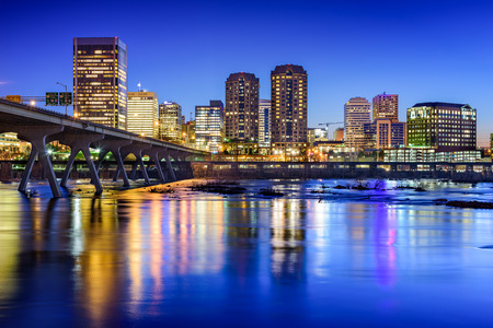 night view: Richmond, Virginia, USA downtown skyline on the James River.