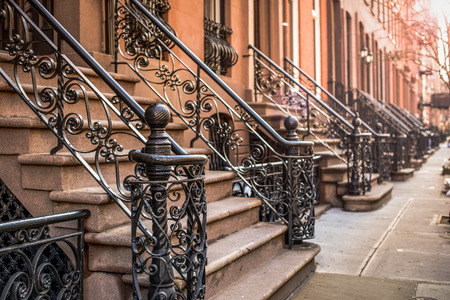 apartment       buildings: Brownstone Apartment steps in the Chelsea neighborhood of New York City.