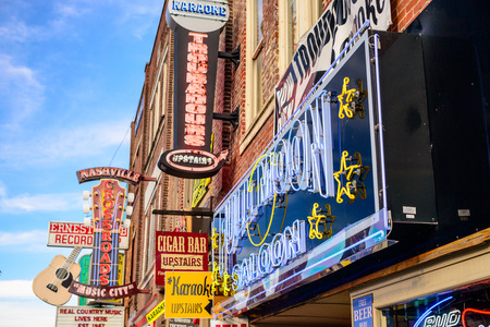 NASHVILLE, TENNESSEE - JUNE 14, 2013: Honky-tonks on Lower Broadway. The district is famous for the numerous country music entertainment establishments. Editorial