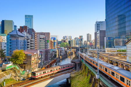 tokyo city: JANUARY 2, 2013: Trains pass over the Kanda River in the Ochanomizu district of Tokyo.