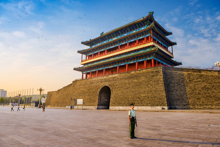 gatehouse: BEIJING, CHINA - JUNE 24, 2014: A soldier stands guard at Zhengyangmen Gatehouse in Tiananmen Square.