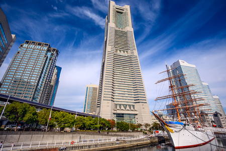 maru: YOKOHAMA, JAPAN - NOVEMBER 9, 2012: Landmark Tower and Nippon Maru ship museum in Nippon Maru Memorial Park.