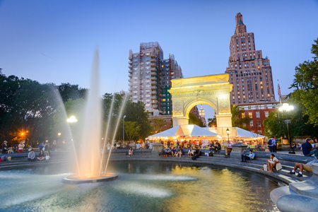 NEW YORK CITY - SEPTEMBER 12, 2012: Crowds gather at Washington Square Park. The historic park is popular in the summer. Editorial