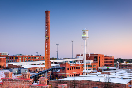 renewal: DURHAM NORTH CAROLINA  MARCH 28 2015: The American Tobacco Historic District. Once the headquarters of the American Tobacco Company the site is now part of a downtown urban renewal project.