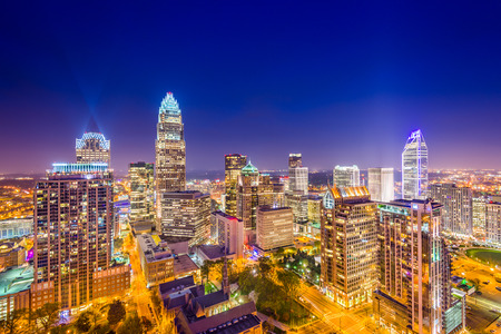 aerial city: Charlotte, North Carolina, USA uptown skyline at night.