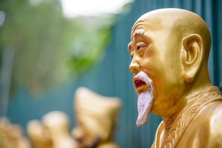 Statues at Ten Thousand Buddhas Monastery in Sha Tin, Hong Kong, China. photo
