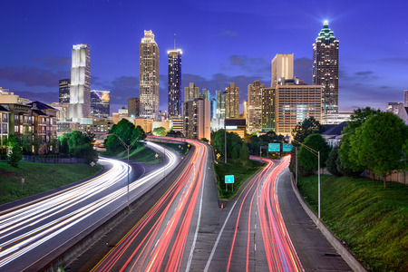 atl: Atlanta, Georgia, USA downtown city skyline over Freedom Parkway.