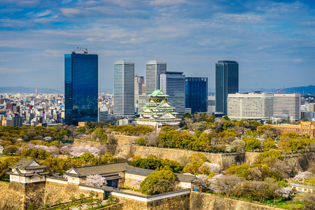 castle district: Osaka, Japan city skyline at the castle and business park.