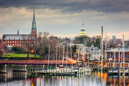 Annapolis, Maryland, USA State House and St. Marys Church viewed over Annapolis Harbor and Compromise Bridge.