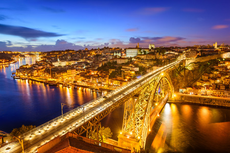 city by night: Porto, Portugal cityscape over Dom Luis I Bridge.