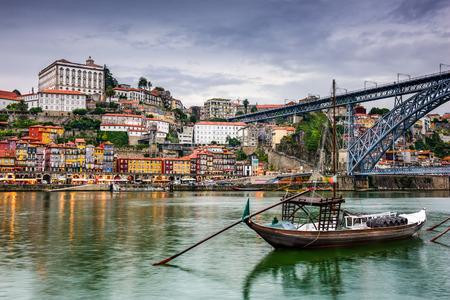 douro: Porto, Portugal skyline on the Douro River at dusk.