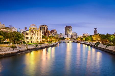 bombed city: Hiroshima, Japan city skylilne on the Otogawa River near the Atomic Dome memorial ruins. Stock Photo