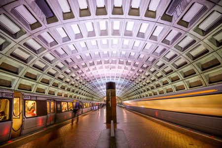 subway platform: WASHINGTON, D.C. - APRIL 10, 2015: Trains and passengers in a Metro Station. Opened in 1976, the Washington Metro is now the second-busiest rapid transit system in the U.S.