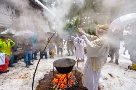 purifying: NAGANO, JAPAN - FEB 4, 2013: Shinto Ascetics perform ancient purifying rites. Known as Yamabushi, they are mountain hermits with a long tradition of mysticism. Editorial