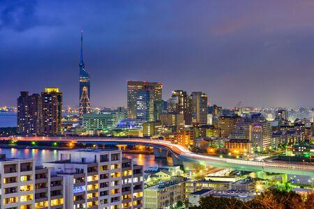 Fukuoka, Japan city skyline at night.