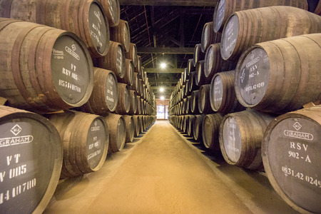casks: PORTO, PORTUGAL OCTOBER 16, 2014: Wine ages at Grahams Port Lodge. The lodge dates from 1890.
