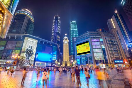 timelapse: CHONGQING, CHINA - JUNE 1, 2014: People stroll through the Jiefangbei CBD pedestrian mall. The district is considered the most prominent financial district in the interior of China. Editorial