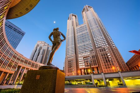 govern: TOKYO, JAPAN - AUGUST 3, 2015: The Tokyo Metropolitan Government building. The building is headquarters of the Tokyo Metropolitan Government which governs 23 wards and outlying cities of Tokyo.