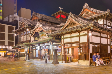 onsen: MATSUYAMA, JAPAN - DECEMBER 3, 2012: Tourists at Dogo Onsen bath house. It is one of the oldest bath houses in the country.