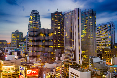 TOKYO, JAPAN - AUGUST 15, 2015: The West Shinjuku skyscraper district of Tokyo. The district is the main financial hub of the city. Editöryel