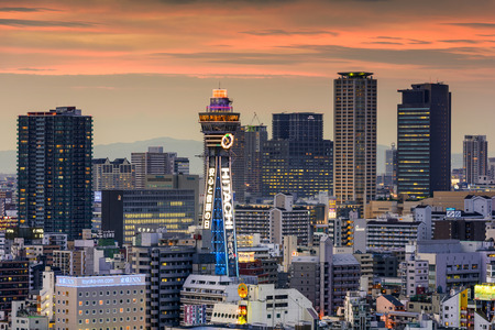 occupy: OSAKA, JAPAN - AUGUST 17, 2015: Tsutenkaku tower in the Shinsekai district. The current tower is the second to occupy the site after the first was destroyed by fire in 1943.