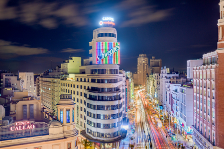madrid: MADRID, SPAIN - OCTOBER 15, 2014: Gran Via at the Iconic Schweppes sign. The street is the main shopping district of Madrid. Editorial