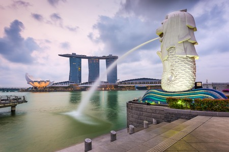 personification: SINGAPORE - SEPTEMBER 6, 2015: The Merlion fountain at Marina Bay. The merlion is a marketing icon used as a mascot and national personification of Singapore.