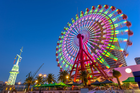 night view: Kobe, Japan at the port Ferris Wheel.