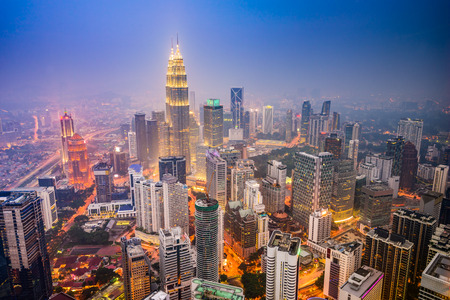night highway: Kuala Lumpur, Malaysia city skyline.