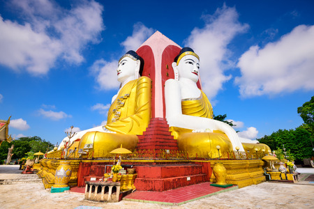 buddha statue: Bago, Myanmar Four Faces of Buddha at Kyaikpun Buddha.