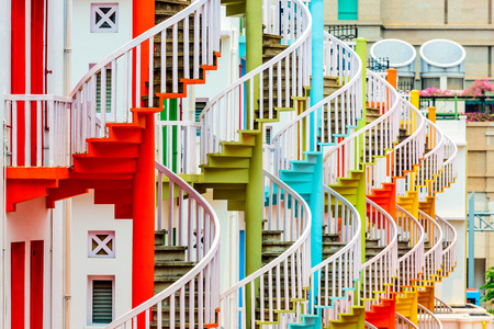 building color: bugis village; bugis; singapore; stairs; spiral staircase; staircase; exterior; building; stairwell; fire escape; colorful; color; architecture; asia; asian; malay; malaysia; apartments; stores; shops; exit; entrance; front door; backdoor; back door; fron