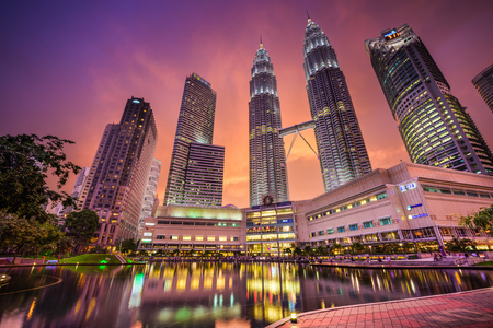 shopping scene: Kuala Lumpur, Malaysia at KLCC Park and Petronas Towers.
