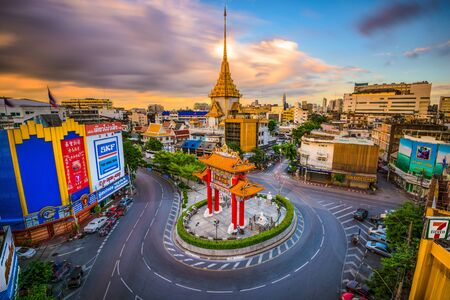 chinatown: BANGKOK, THAILAND - SEPTEMBER 23, 2015: The Chinatown gate traffic circle with Wat Traimit behind.