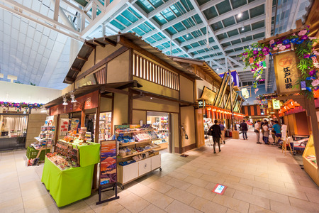 TOKYO - SEPTEMBER 1, 2015: Haneda airport at the Edo town shops. The shops sell tourists goods from Edo era recreation buildings inside the terminal.