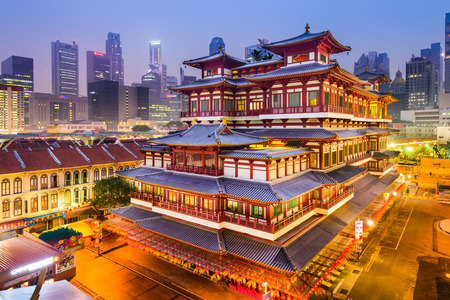 tang: SINGAPORE - SEPEMBER 9, 2015: Buddha Tooth Relic Temple at twilight. The temple is based on Tang dynasty architecture and built to house the tooth relic of Buddha.