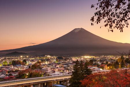 tokyo prefecture: Mt. Fuji rises over Fujiyoshida, Japan in autumn.